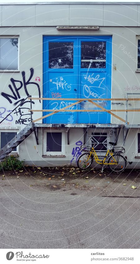 Bike in front of cheap dosshouse Bicycle Stairs Entrance Blue Handrail makeshift Banister Architecture Upward Yellow Downward Landing