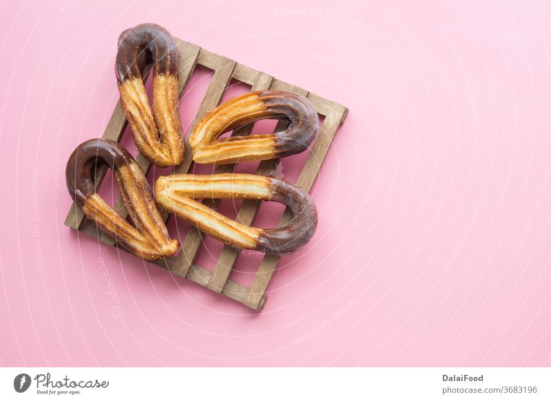 Churros with chocolat typical  sweet breakfast background baked brown caramel chocolate churro churros cinnamon closeup cooking cuisine cup delicious dessert