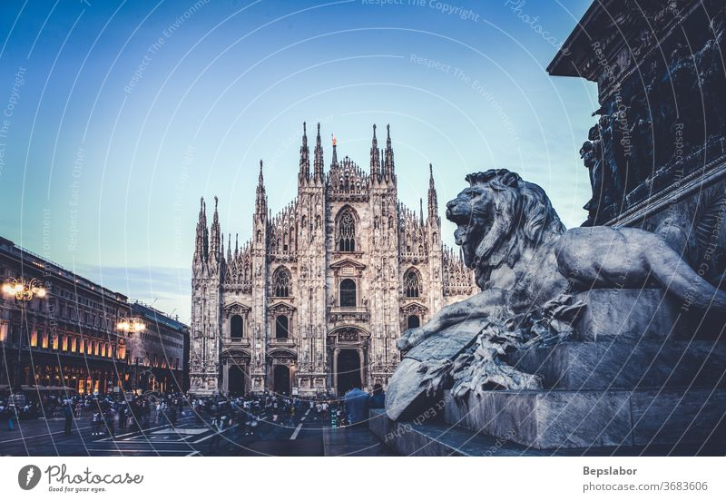Lion, sculpture of the Vittorio Emanuele II monument in Piazza Duomo, Milan - Italy antique architecture art carving cathedral celebration christianity church