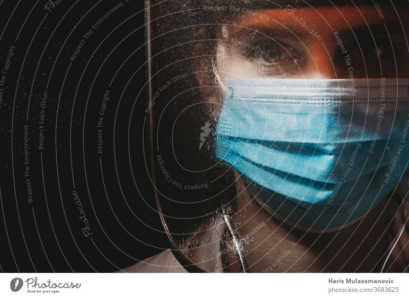 Female doctor with face shield on black background covid-19 coronavirus 2020 air mask choose clinic corona doctor corona epidemic corona vaccine