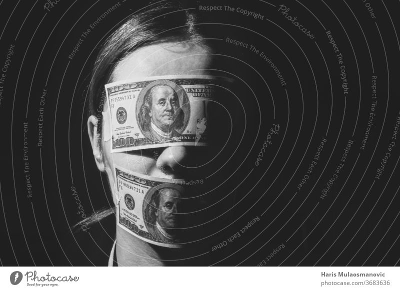 Woman with dollar bills covering her eyes and mouth, concept for economy,workers, wealth, corruption 100 america american bank banking banknote black background