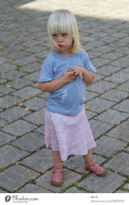 ...and the game is suspended due to injury... Child girl Playing Summer Small Toddler Skirt Summery Summer's day Blonde 1 Earnest Seriousness Sulk Pout hands