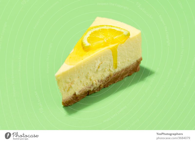 Cheesecake slice with lemon syrup topping. Slice of cheesecake close-up background baked bakery baking breakfast bright christmas citrus classic colors cooking