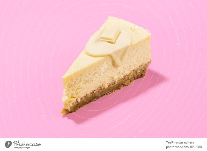 Cheesecake slice with white chocolate topping. One slice of cheesecake close-up background baked bakery baking breakfast bright christmas classic colors cooking