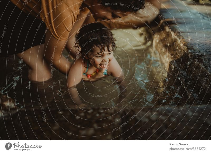 Child in the pool with mother Children's game childhood Childhood memory Mother motherhood Family & Relations Lifestyle Leisure and hobbies Exterior shot Joy