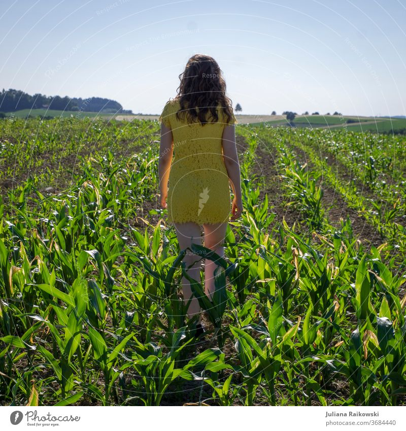 Girl in yellow dress in a cornfield Maize field Field Summer Agriculture Plant Nature Green Agricultural crop Environment Exterior shot Sky Colour photo