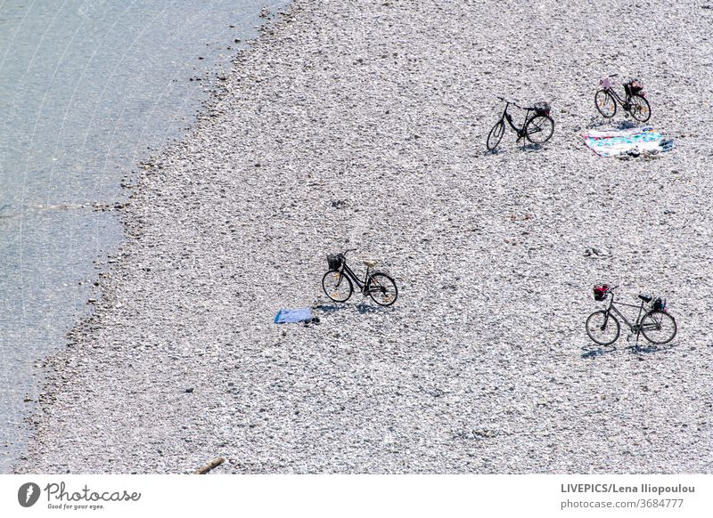 Bicycles on the beach waiting for the owners background bicycle blue copy space day daylight lake leisure nature river shore strand summer sun sunny water