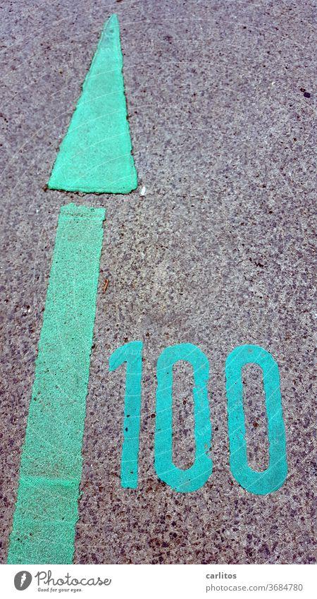 100 ( %, years, kilos, etc ) one hundred number digit mark Arrow Direction green Asphalt Orientation Road marking Sign Navigation waypoint Clue tip navi