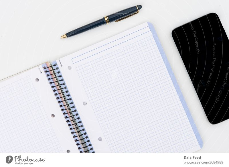 Pen, notepad and mobil with wooden puzzle pieces on white background above blank business coffee copy design desk empty eyeglasses flat lay memo mobile notebook