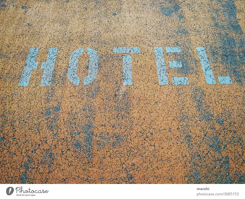 HOTEL Hotel Street parking area Parking lot Concrete travel voyage urban Detail on the outside Orange Abstract Town Letters (alphabet) Word Travel warning