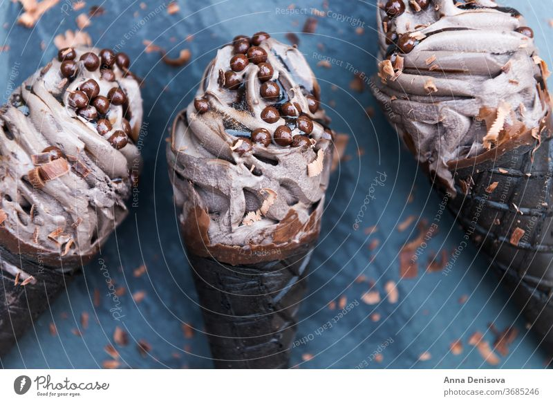 Double Chocolate Ice Creams with Black Waffle Cones ice cream black charcoal double chocolate waffle trendy cone food goth japanese sweet dessert bamboo cold