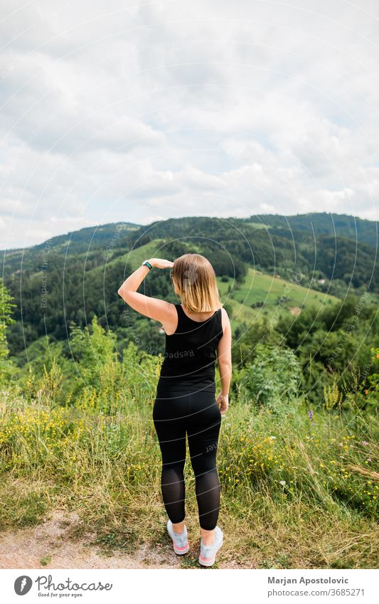 Young woman enjoying the view of a beautiful mountain range adventure destination explore explorer exploring female forest free freedom girl healthy hike hiker