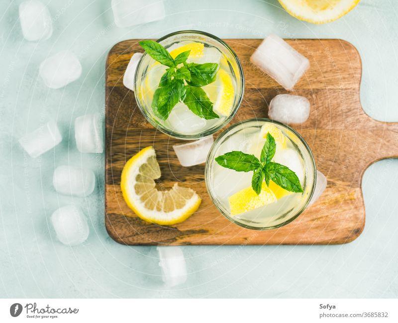 Fresh lemon lemonade in jug and glasses summer drink beverage top view cocktail mint food flat lay juice vintage fruit leaf spring citrus gin vodka infused