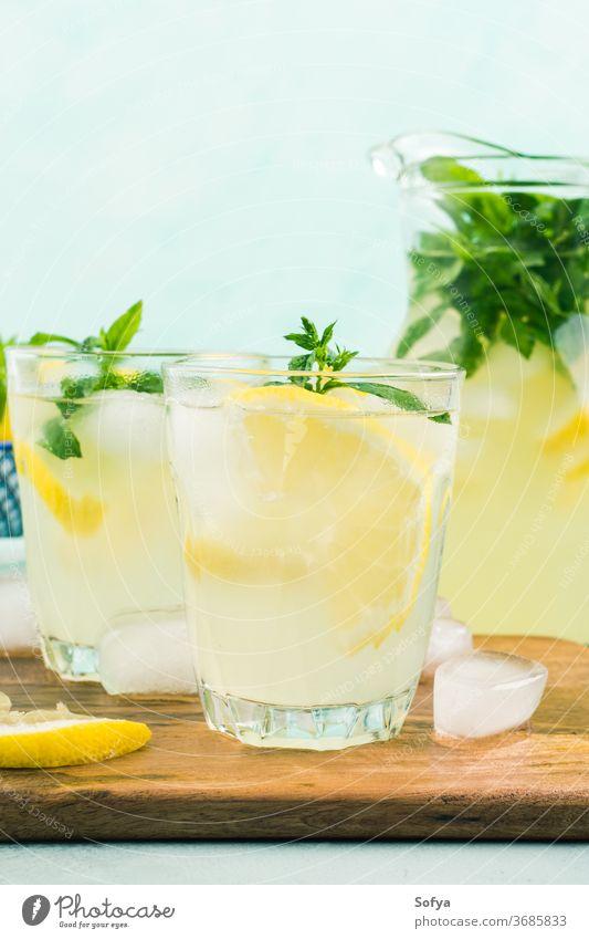 Fresh lemon lemonade in jug and glasses summer italian beverage cocktail drink sweet healthy fruit leaf spring juice citrus mint gin vodka infused alcohol