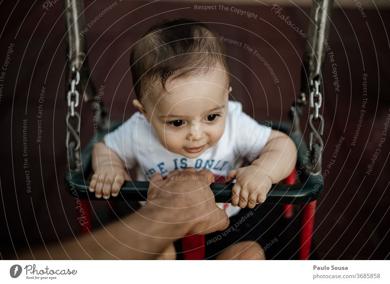 Father holding baby on the swing Swing Playground Together togetherness fatherhood Baby babyhood point of view Lifestyle family people Love care Parents