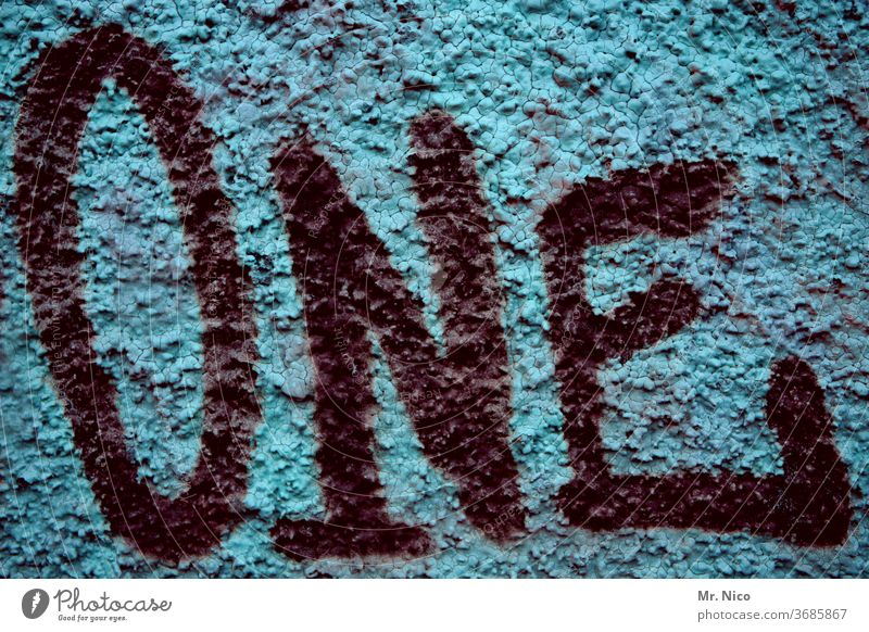 one 1 Digits and numbers Characters Letters (alphabet) Graffiti Blue Black Wall (building) Facade Number one Wall (barrier) Signs and labeling English Detail
