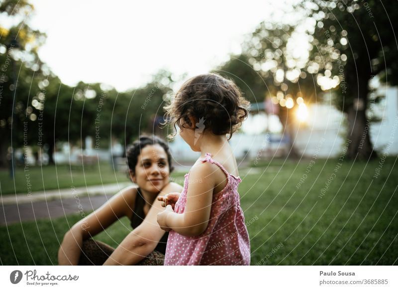 Daughter looking to Mother Together togetherness motherhood Mother with child Family & Relations Lifestyle Playground Park Summer Summer vacation Beautiful