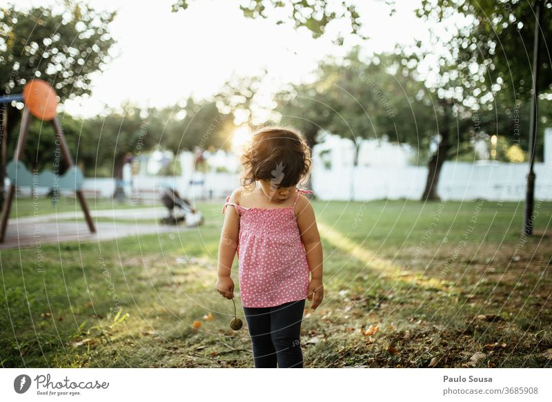 Little girl standing in playground Playground Park Girl Child childhood Caucasian 1 - 3 years Infancy Exterior shot Colour photo Toddler Cute