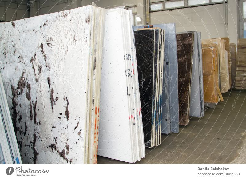 Colorful marble slabs in store show room. Granite slabs are prepared for sale in store yard granit nacre countertop stock industry industrial polished stone