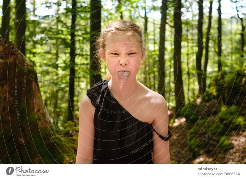 Wild girl in the forest sticks out her tongue Forest portrait Child Infancy Childhood memory Parenting Playing Exterior shot Joy Family & Relations Summer