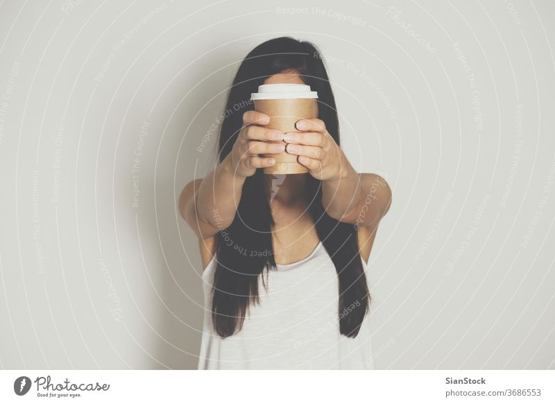 Woman holding brown paper cup of hot coffee. isolated white drink hand woman background disposable cafe lid container caffeine breakfast icon design drinking