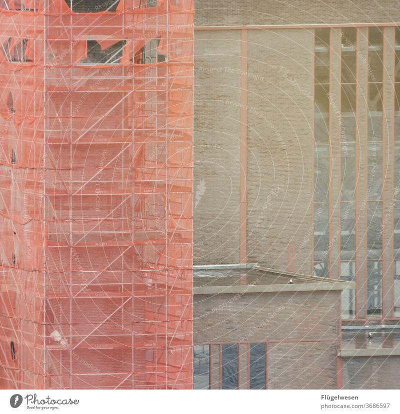 shrouded built Part of a building Building exterior Building facade Complex of buildings building front Armour armament technology Scaffolding Scaffolder