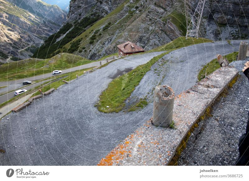 Old serpentine road in the high alps Winding road Alps High Alps pass road Tar Mountain Steep ascent Narrow curvaceous Curve Transport Street Landscape Nature