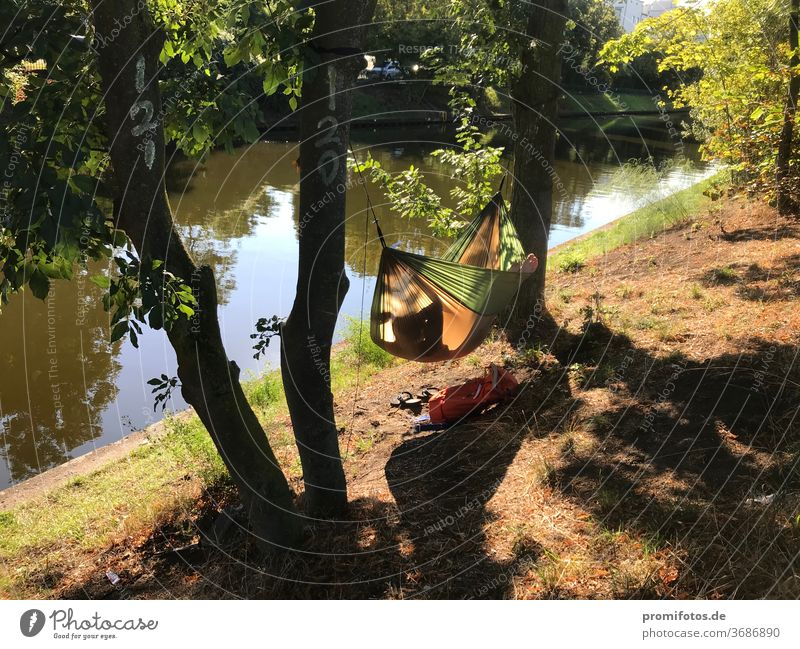 Relax in the evening in the hammock by the water. Photo: Alexander Hauk free time vacation Tourism Hammock Water bank huts Nature Exterior shot Sunlight Evening