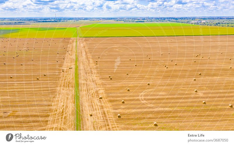 Aerial view of dirty road among agricultural fields Above Across Agricultural Agriculture Among Amongst Bale Between Border Cereal Confine Countryside Crop Dirt