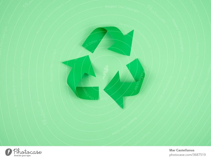 Recycling logo on paper on a green background recycling copy space ecology modern current clean company ecological icon concept symbol environment recycled
