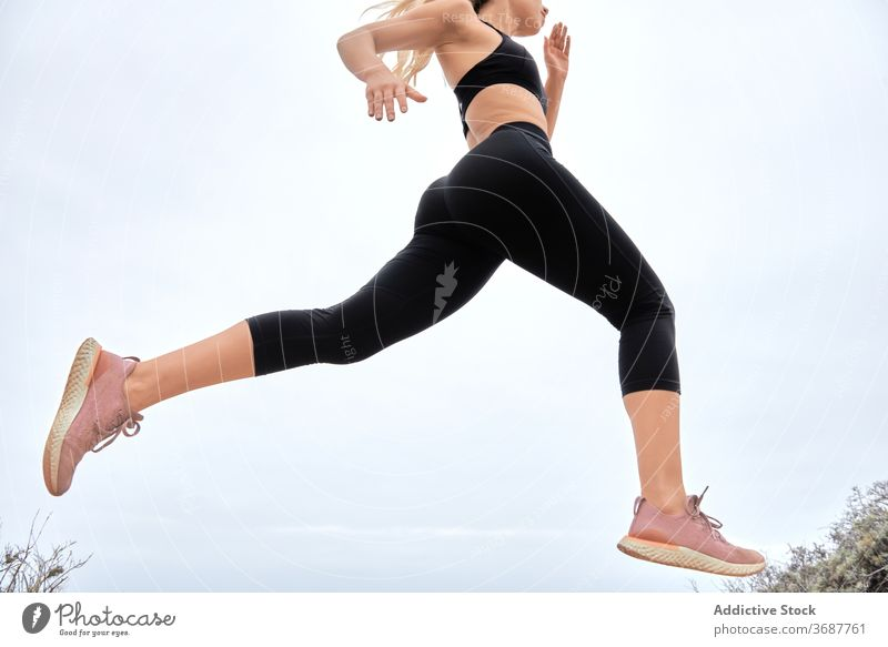Young athletic woman training at seaside run workout fitness sportswoman young slim athlete female exercise modern wellness wellbeing healthy lifestyle seashore
