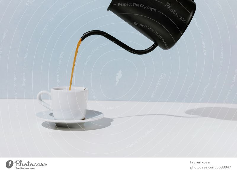 Coffee poured from black metal pot white cup, selective focus cafe aroma beverage breakfast caffeine coffee drink espresso food hand hot morning mug pouring