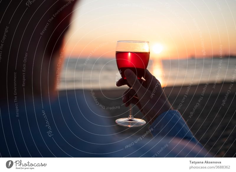 Man with glass of wine on beach at sunset drink alcohol romantic enjoying slow living relax sea beautiful celebration beverage silhouette romance holiday nature