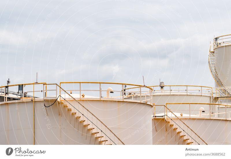 Closeup fuel storage tank in petroleum refinery. White big tank of oil storage. Fuel silo. Liquid petroleum tank. Petroleum oil industrial. Fuel station. Oil refinery plant. Petrochemical industry.