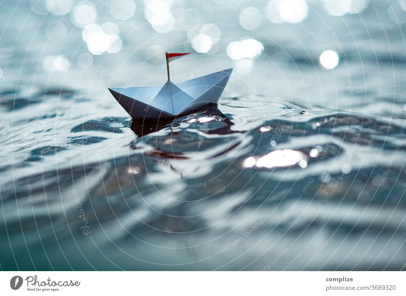 Small paper ship on a sparkling lake Sunbeam Sunlight Light (Natural Phenomenon) Reflection Colour photo Glittering Travel photography Paper boat Target