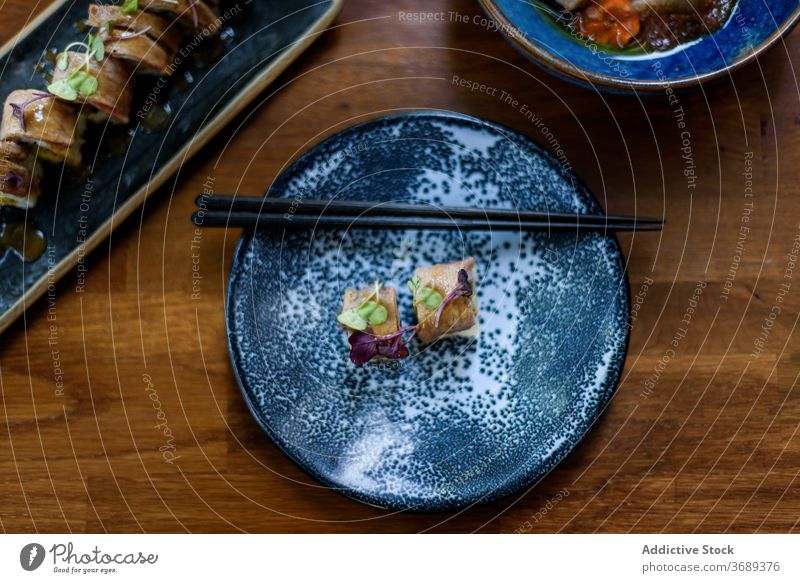 Delicious sushi served on plate with chopsticks salmon roll restaurant appetizing asian food fresh bamboo rice tasty seafood gourmet tradition delicious dish