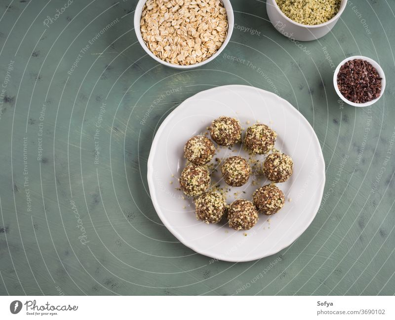 Energy protein balls with nuts, hemp seeds energy balls bites almond butter flax dessert dark chocolate cocoa oats nutrition low sugar oatmeal date apricot