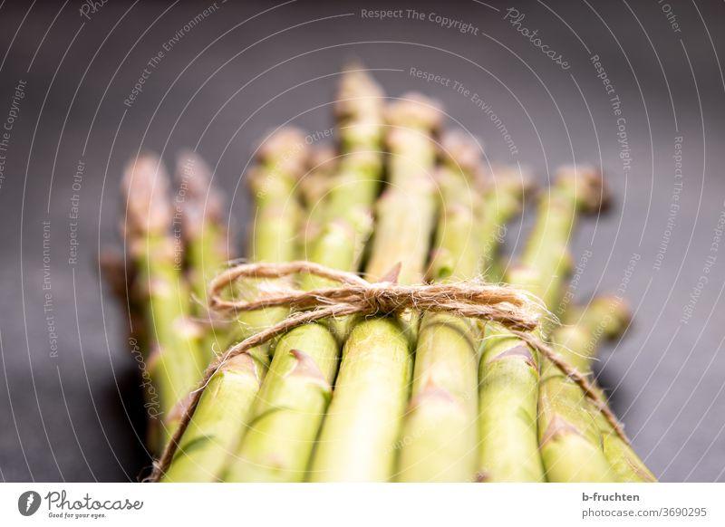 a bunch of green asparagus Vegetable Asparagus Nutrition Vegetarian diet Organic produce Healthy Eating Asparagus season Asparagus spears Bunch of asparagus