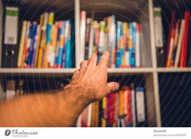 Reach into the bookshelf Bookshelf Reading Literature Study practice Examinations and Tests Textbook School Academic studies read up lookup Know