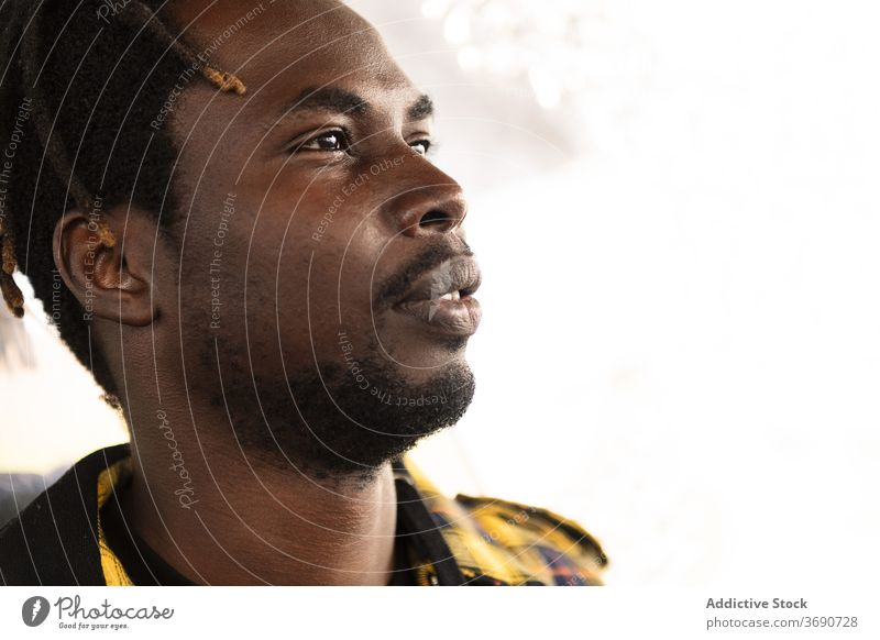 Portrait of an attractive young black man person portrait male african guy american handsome looking lifestyles confident model confidence expression afro cool
