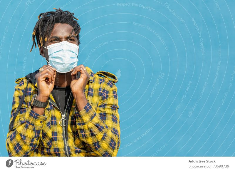 young black man wearing a protective mask person portrait african protection disease copyspace virus male epidemic flu health face coronavirus medical care