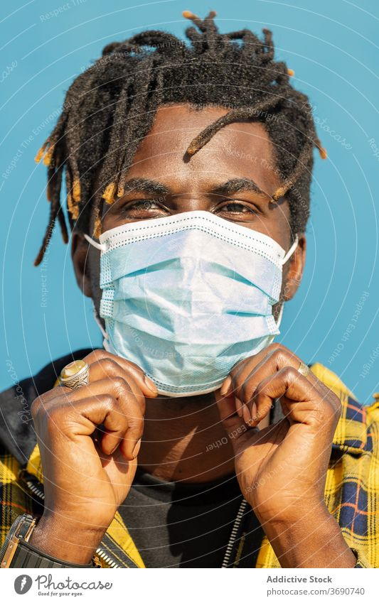vertical closeup of black man with protective mask person portrait close-up african protection disease virus male epidemic flu health face coronavirus medical