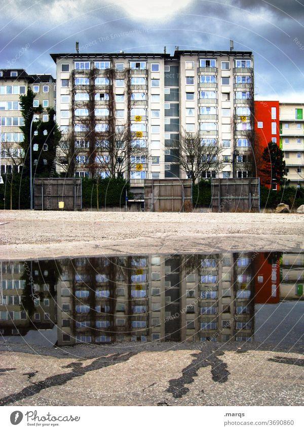 rent index Reflection Apartment Building Sky Puddle Mirror image Storm clouds Apartment house Rent
