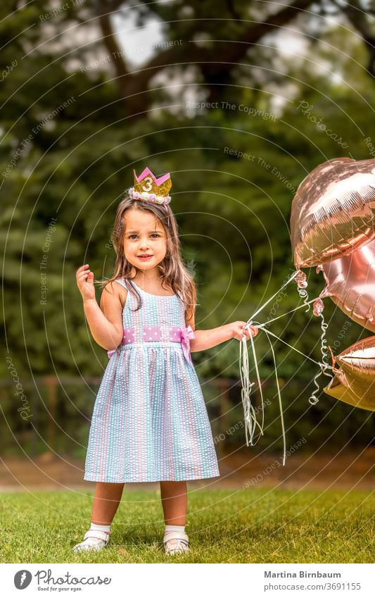 3-year-old birthday girl with her balloons outdoors child celebration cheerful childhood toddler cute kid adorable daughter present family pretty surprise