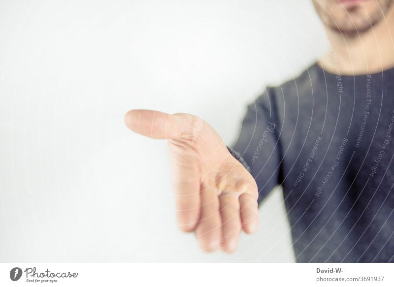phrase - reaching out to someone | man reaching out Reaching out to someone by hand Human being Man stretch out by hand extend a hand peace offer Apology