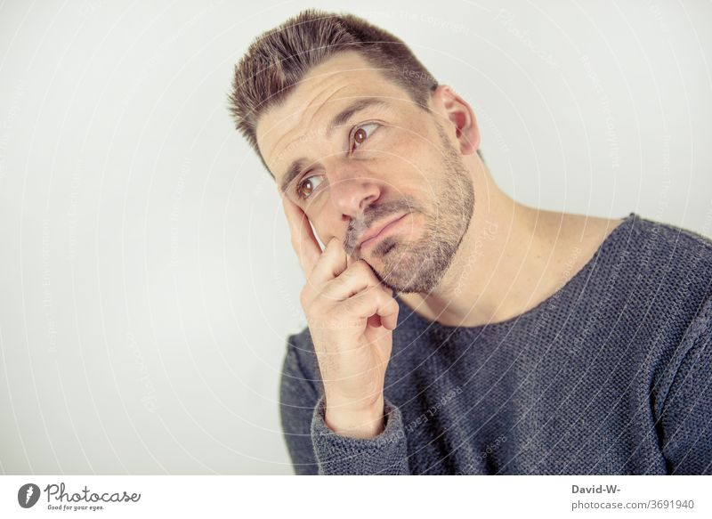 Man lost in thought thoughts Manly think ponder Meditative Think tarpaulin Future Copy Space Copy Space top Copy Space left Face Looking Adults Colour photo