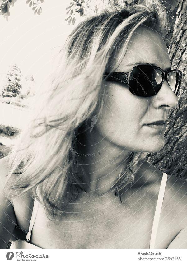 young woman with sunglasses Black/White Woman Sunglasses long hair Summer Gray somber Meditative Bikini Feminine Human being portrait 40-45 years natural Day