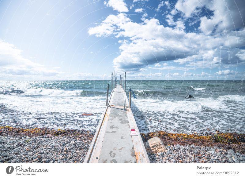 Small bridge to the cold sea wind dramatic deck denmark scandinavia nordic fresh morning pathway lakeshore marina daytime footbridge cloud seascape pacific