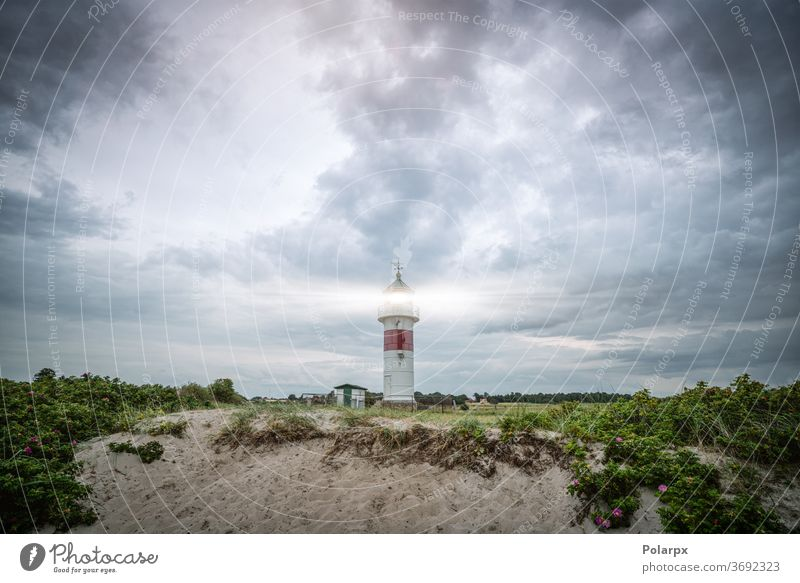 Lighthouse in cloudy weather storm stormy cloudscape north beautiful old nautical outdoors sunset coastal cloudy sky seascape famous horizon sunlight stone