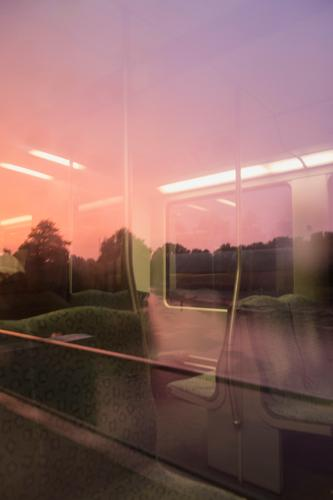 pink train ride Track Trip Pink lamps Metal Light Twilight Evening Party Longing Weekend seats void Intersection Window travel Unknown Transport transit